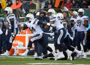Jan 5, 2014; Cincinnati, OH, USA; San Diego Chargers linebacker Melvin Ingram (54) celebrates with teammates Reggie Walker (52), Manti Te