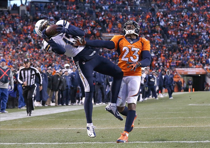 Jan 12, 2014; Denver, CO, USA; San Diego Chargers receiver Keenan Allen (13) catches a touchdown pass in the third quarter against Denver Broncos cornerback Quentin Jammer (23) during the 2013 AFC divisional playoff football game at Sports Authority Field at Mile High. The Broncos beat the Chargers 24-17. Mandatory Credit: Matthew Emmons-USA TODAY Sports