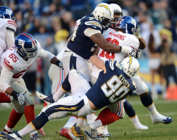 Dec 8, 2013; San Diego, CA, USA; SSan Diego Chargers linebacker Thomas Keiser (90) and defensive end Corey Liuget (94) sack New York Giants quarterback Eli Manning (10) in the fourth quarter at Qualcomm Stadium. Mandatory Credit: Jayne Kamin-Oncea-USA TODAY Sports