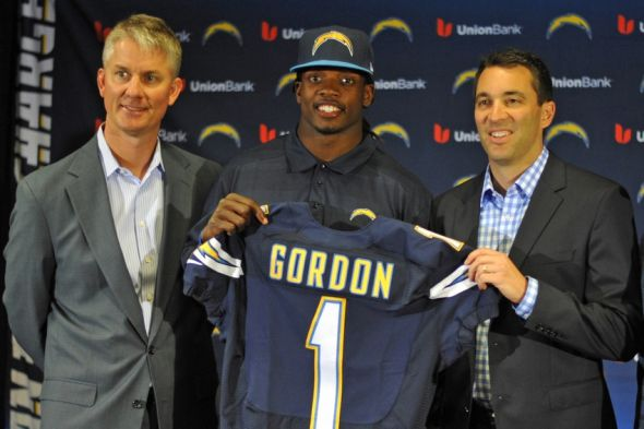May 1, 2015; San Diego, CA, USA; San Diego Chargers first round draft pick Melvin Gordon (C) holds his Chargers jersey next to head coach Mike McCoy (L) and general manager Tom Telesco (R) at Charger Park. Mandatory Credit: Jake Roth-USA TODAY Sports
