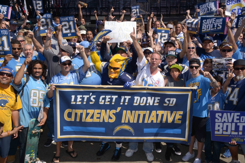 Apr 23 2016 San Diego CA USA San Diego Chargers fan Dan Jauregui aka Boltman poses with Charger fans during rally to gather signatures for citizen