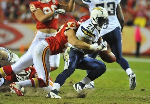 Oct 31, 2011; Kansas City, MO, USA; Kansas City Chiefs strong safety Jon McGraw (47) tackles San Diego Chargers running back Ryan Mathews (24) in the second quarter at Arrowhead Stadium. Mandatory Credit: Denny Medley-US PRESSWIRE