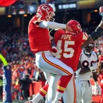 Dec 5, 2010; Kansas City, MO, USA; Kansas City Chiefs quarterback Matt Cassel (7) congratulates tight end Leonard Pope (45) after Pope