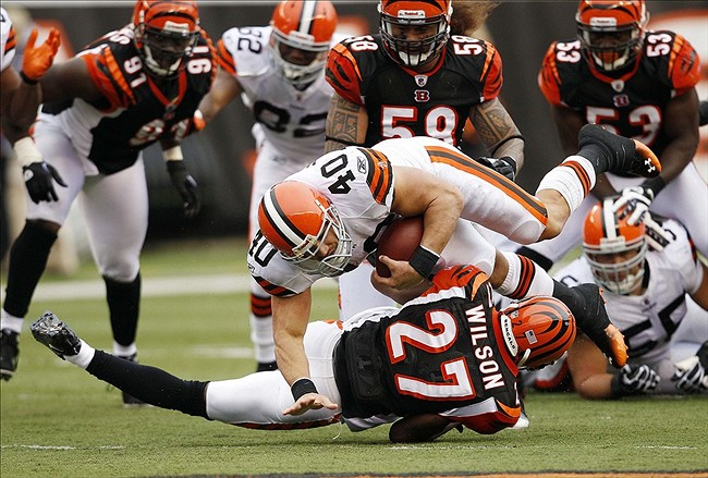 Nov 27, 2011; Cincinnati, OH, USA; Cleveland Browns running back Peyton Hillis (40) is brought down by Cincinnati Bengals defensive back Gibril Wilson (27) during the first half at Paul Brown Stadium. Mandatory Credit: Frank Victores-US PRESSWIRE