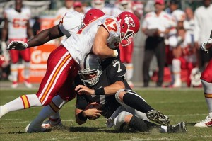 Oct 23, 2011; Oakland, CA, USA; Oakland Raiders quarterback Kyle Boller (7) is tackled by Kansas City Chiefs strong safety Jon McGraw (47) in the first quarter at O.co Coliseum. Mandatory Credit: Cary Edmondson-US PRESSWIRE