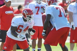 July 27, 2012; St. Joseph, MO, USA; Kansas City Chiefs offensive lineman Tony Ugoh (64) and Lucas Patterson (70) run drills during training camp at Missouri Western State University. Mandatory Credit: Denny Medley-US PRESSWIRE