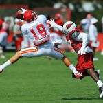 Aug 07, 2012; St. Joseph, MO, USA; Kansas City Chiefs wide receiver Devon Wylie (19) catches a pass as Arizona Cardinals defensive back Michael Adams (27) defends during the Kansas City Chiefs and Arizona Cardinals practice at Missouri Western State University. Mandatory Credit: Denny Medley-US PRESSWIRE