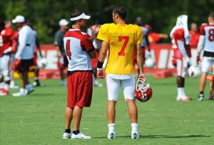 Aug 07, 2012; St. Joseph, MO, USA; Arizona Cardinals quarterback Kevin Kolb (4) and Kansas City Chiefs quarterback Matt Cassel (7) talk during a break at the Kansas City Chiefs and Arizona Cardinals practice at Missouri Western State University. Mandatory Credit: Denny Medley-US PRESSWIRE