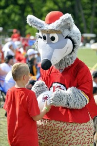 Aug 07, 2012; St. Joseph, MO, USA; Kansas City Chiefs mascot KC Wolf signs autographs for fans during the Kansas City Chiefs and Arizona Cardinals practice at Missouri Western State University. Mandatory Credit: Denny Medley-US PRESSWIRE