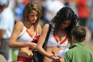 Aug 07, 2012; St. Joseph, MO, USA; Kansas City Chiefs cheerleaders sign autographs for fans during the Kansas City Chiefs and Arizona Cardinals practice at Missouri Western State University. Mandatory Credit: Denny Medley-US PRESSWIRE