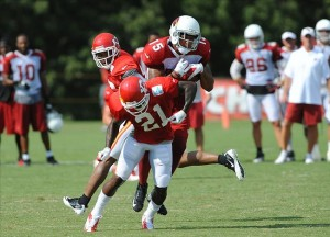 Aug 07, 2012; St. Joseph, MO, USA; Arizona Cardinals wide receiver Michael Floyd (15) catches a pass as Kansas City Chiefs defensive back Javier Arenas (21) defends during the Kansas City Chiefs and Arizona Cardinals practice at Missouri Western State University. Mandatory Credit: Denny Medley-US PRESSWIRE
