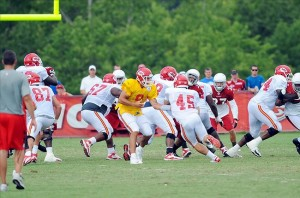 Aug 07, 2012; St. Joseph, MO, USA; Kansas City Chiefs quarterback Brady Quinn (9) hands off to running back Nate Eachus (45) during the Kansas City Chiefs and Arizona Cardinals practice at Missouri Western State University. Mandatory Credit: Denny Medley-US PRESSWIRE