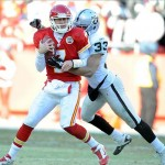 Jan 2, 2011; Kansas City, MO, USA; Oakland Raiders safety Tyvon Branch (33) sacks Kansas City Chiefs quarterback Matt Cassel (7) in the second half at Arrowhead Stadium. Oakland won the game 31-10. Mandatory Credit: John Rieger-US PRESSWIRE