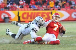 Jan 02, 2011; Kansas City, MO, USA; Kansas City Chiefs quarterback Matt Cassel (7) is sacked by Oakland Raiders defensive end Lamarr Houston (99) in the second half of the game at Arrowhead Stadium. Oakland won 31-10. Mandatory Credit: Denny Medley-US PRESSWIRE