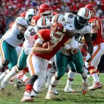 November 6, 2011; Kansas City, MO, USA; Kansas City Chiefs quarterback Matt Cassel (7) is sacked by Miami Dolphins defensive tackle Tony McDaniel (78) and Miami Dolphins inside linebacker Kevin Burnett (56) during the first quarter at Arrowhead Stadium. Mandatory Credit: Dak Dillon-US PRESSWIRE