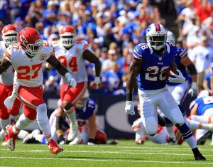 Sep 16, 2012; Orchard Park, NY, USA; Buffalo Bills running back C.J. Spiller (28) runs as Kansas City Chiefs free safety Abram Elam (27) pursues during the second quarter at Ralph Wilson Stadium. Mandatory Credit: Kevin Hoffman-US PRESSWIRE