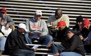 Jan 22, 2013; Mobile AL, USA; Kansas City Chiefs general manager John Dorsey discusses with his scouts and coaches following the Senior Bowl South Squad practice at Ladd-Peebles Stadium. Mandatory Credit: John David Mercer-USA TODAY Sports