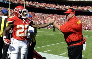 Sep 29, 2013; Kansas City, MO, USA; Kansas City Chiefs wide receiver Dexter McCluster (22) is congratulated by head coach Andy Reid (right) after returning a punt for a touchdown against the New York Giants in the second half at Arrowhead Stadium. Kansas City won the game 31-7. Mandatory Credit: John Rieger-USA TODAY Sports