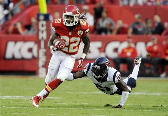 Oct 20, 2013; Kansas City, MO, USA; Kansas City Chiefs wide receiver Dexter McCluster (22) gets past Houston Texans cornerback Brice McCain (21) in the second half at Arrowhead Stadium. The Chiefs won 17-16. Mandatory Credit: John Rieger-USA TODAY Sports