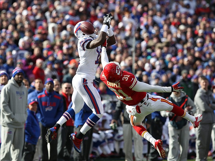 Nov 3, 2013; Orchard Park, NY, USA; Kansas City Chiefs cornerback Marcus Cooper (31) breaks up a pass to Buffalo Bills wide receiver T.J. Graham (11) during the first half at Ralph Wilson Stadium. Mandatory Credit: Timothy T. Ludwig-USA TODAY Sports