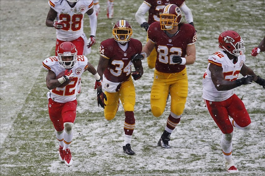 Dec 8, 2013; Landover, MD, USA; Kansas City Chiefs wide receiver Dexter McCluster (22) scores a touchdown on a punt return against the Washington Redskins in the second quarter at FedEx Field. Mandatory Credit: Geoff Burke-USA TODAY Sports