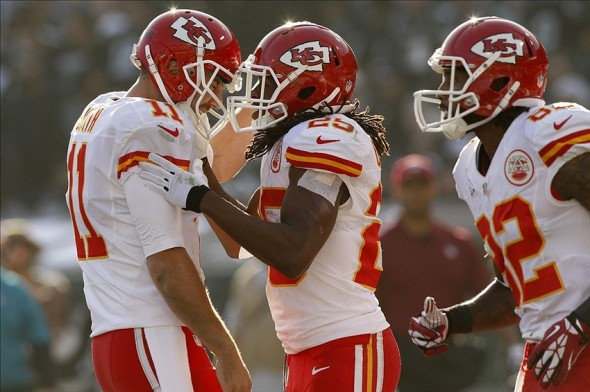 Dec 15, 2013; Oakland, CA, USA; Kansas City Chiefs running back Jamaal Charles (25) is congratulated by quarterback Alex Smith (11) after catching a touchdown pass against the Oakland Raiders in the second quarter at O.co Coliseum. Mandatory Credit: Cary Edmondson-USA TODAY Sports