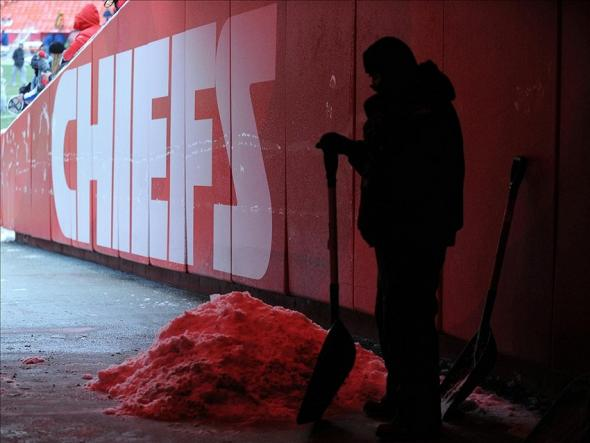 Dec 22, 2013; Kansas City, MO, USA; A worker clears snow from the tunnel before the game between the Kansas City Chiefs and Indianapolis Colts at Arrowhead Stadium. Mandatory Credit: Denny Medley-USA TODAY Sports