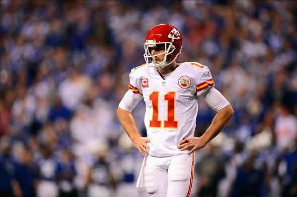 Jan 4, 2014; Indianapolis, IN, USA; Kansas City Chiefs quarterback Alex Smith (11) looks to the sidelines during the first quarter of the 2013 AFC wild card playoff football game against the Indianapolis Colts at Lucas Oil Stadium. Mandatory Credit: Andrew Weber-USA TODAY Sports