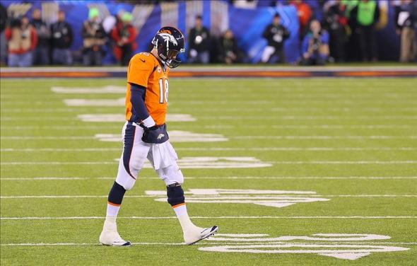 Feb 2, 2014; East Rutherford, NJ, USA; Denver Broncos quarterback Peyton Manning (18) on the field during the first half against the Seattle Seahawks in Super Bowl XLVIII at MetLife Stadium. Mandatory Credit: Adam Hunger-USA TODAY Sports