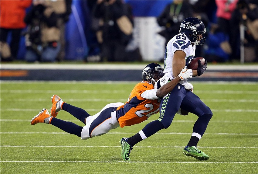 Feb 2, 2014; East Rutherford, NJ, USA; Seattle Seahawks wide receiver Doug Baldwin (89) is tackled by Denver Broncos cornerback Champ Bailey (24) in the second half in Super Bowl XLVIII at MetLife Stadium. Mandatory Credit: Joe Camporeale-USA TODAY Sports