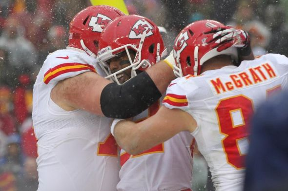 Dec 8, 2013; Landover, MD, USA; Kansas City Chiefs wide receiver Dwayne Bowe (82) celebrates with teammates after scoring a touchdown against the Washington Redskins in the first quarter at FedEx Field. Mandatory Credit: Geoff Burke-USA TODAY Sports