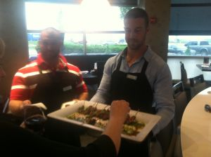 Alex Smith and Anthony Sherman serve appetizers to Chiefs fans who attended Derrick Johnson's Celebrity Waiter Night.