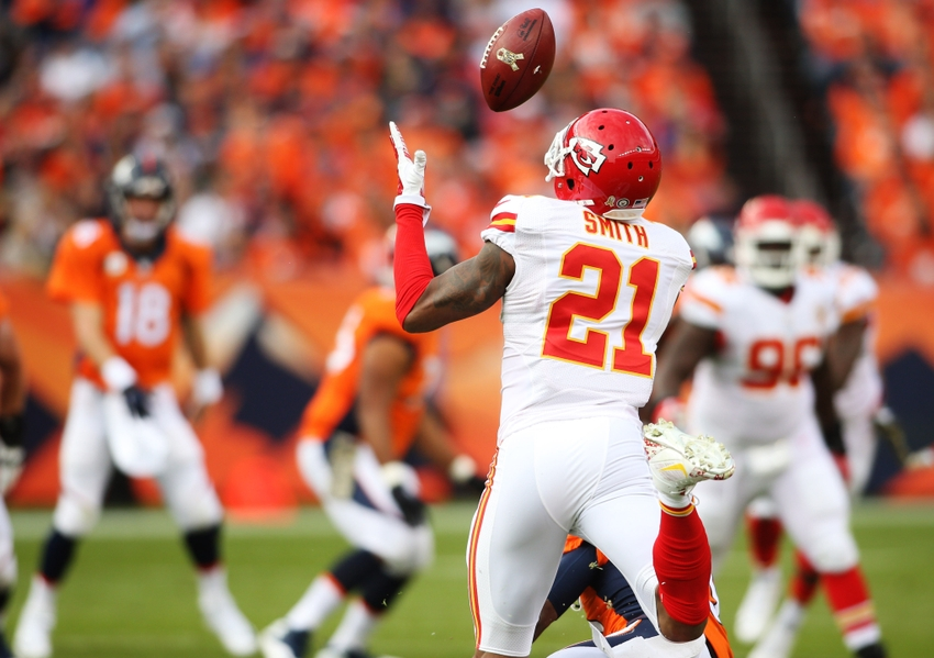 Nov 15, 2015; Denver, CO, USA; Kansas City Chiefs cornerback Sean Smith (21) intercepts a pass thrown by Denver Broncos quarterback Peyton Manning (18) during the first half at Sports Authority Field at Mile High. Mandatory Credit: Chris Humphreys-USA TODAY Sports