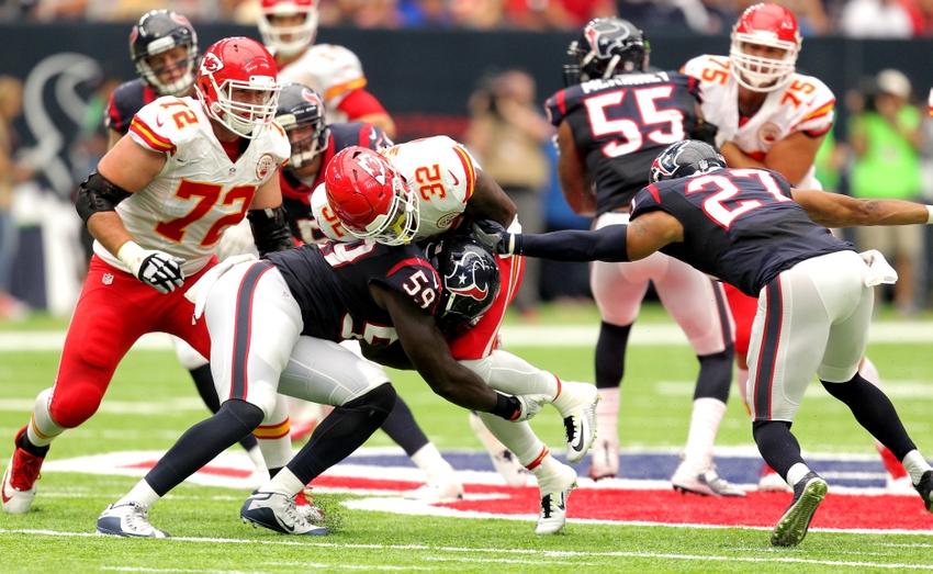 Sep 18, 2016; Houston, TX, USA; Houston Texans outside linebacker Whitney Mercilus (59) forces a fumble on Kansas City Chiefs running back Spencer Ware (32) during the second quarter against the Houston Texans at NRG Stadium. Mandatory Credit: Erik Williams-USA TODAY Sports