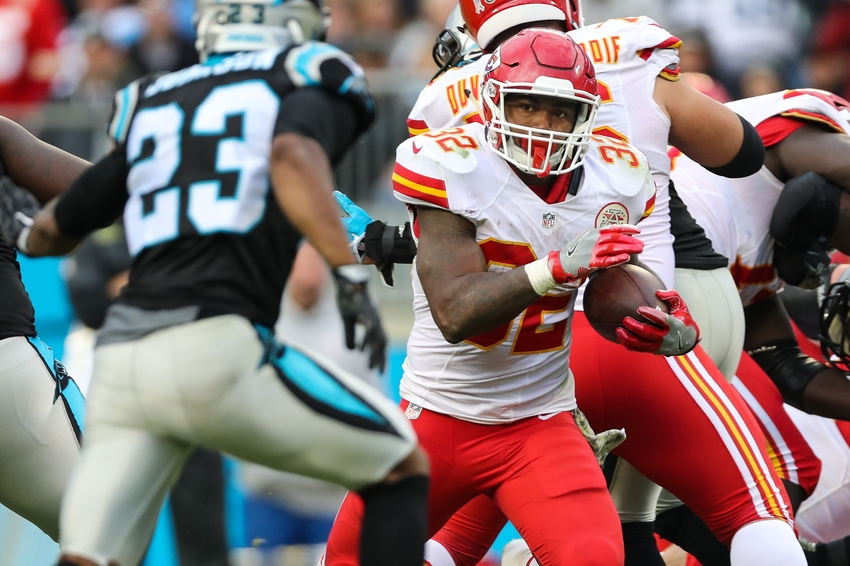 Nov 13, 2016; Charlotte, NC, USA; Kansas City Chiefs running back Spencer Ware (32) looks to elude Carolina Panthers defensive back Leonard Johnson (23) during the second half at Bank of America Stadium. The Chiefs won 20-17. Mandatory Credit: Jim Dedmon-USA TODAY Sports