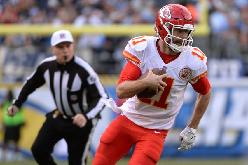 Jan 1, 2017; San Diego, CA, USA; Kansas City Chiefs quarterback Alex Smith (11) runs the ball as referee Walt Anderson (left) follows during the first half of the game against the San Diego Chargers at Qualcomm Stadium. Mandatory Credit: Orlando Ramirez-USA TODAY Sports