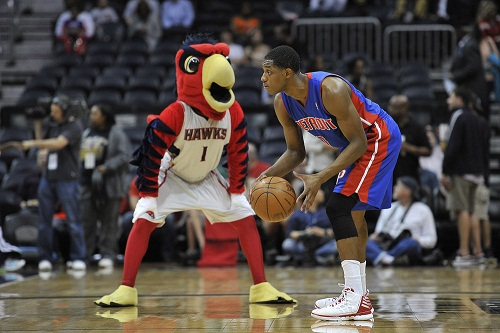 Apr 18, 2012; Atlanta, GA, USA; The Atlanta Hawks mascot Harry the Hawk taunts Detroit Pistons point guard Brandon Knight (7) prior to his game against the Atlanta Hawks at Philips Arena. The Hawks won 116-84. Mandatory Credit: Paul Abell-US PRESSWIRE