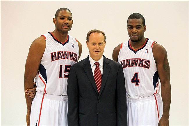 Sep 30, 2013; Atlanta, GA, USA; Atlanta Hawks power forward Al Horford (15) and power forward Paul Millsap (4) pose with head coach Mike Budenholzer (center) during media day at Philips Arena. Mandatory Credit: Daniel Shirey-USA TODAY Sports