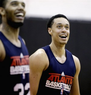 Atlanta Hawks first-round pick John Jenkins, right, and second-round pick Mike Scott, left, look on during NBA basketball practice, Tuesday, July 10, 2012, in Atlanta. With the Hawks' trade of All-Star guard Joe Johnson to the Nets, Jenkins suddenly could be competing for more than just a bench role. His first chance to impress comes in the team's rookie camp, which opened on Tuesday. (AP Photo/David Goldman)