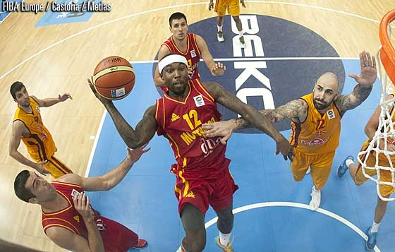 Tyrese Rice (Montenegro/Red) goes by Pero Antic (Macedonia/Yellow) for an easy lay-up in EuroBasket 2013 (Photographer: FIBA Europe / Castoria / Metlas)