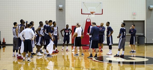 Atlanta head coach Mike Budenholzer speaks to the team after a training camp practice in Athens, Ga., on Tuesday, Oct. 1, 2013. (Photo/Taylor Craig Sutton)
