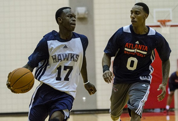 Atlanta guard Dennis Schroder (17) drives past guard Jeff Teague (0) during training camp in Athens, Ga., on Tuesday, Oct. 1, 2013. (Photo/Taylor Craig Sutton)