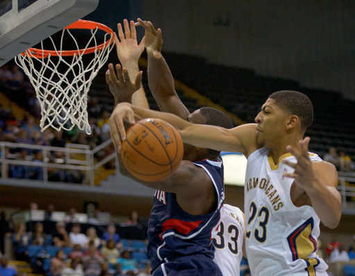 New Orleans Pelicans power forward Anthony Davis (23) blocks a shot of Atlanta Hawks power forward Paul Millsap (4) in a NBA preseason basketball game between the New Orleans Pelicans and the Atlanta Hawks in Biloxi, Miss. Sunday, Oct. 13, 2013. (AP Photo/Matthew Hinton)