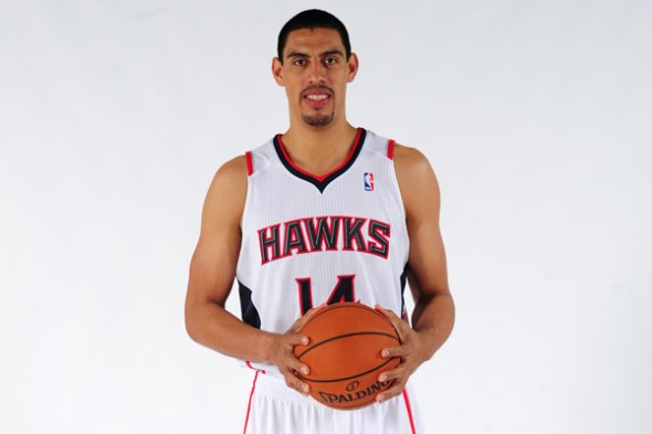 Gustavo Ayon was injured in his preseason debut for the Hawks. (Scott Cunningham/Getty Images)