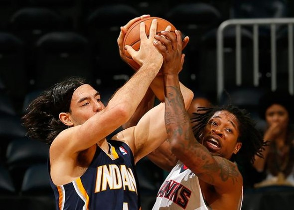 Cartier Martin (Hawks) and Luis Scola (Pacers) fight for a loose ball. (Kevin C. Cox/NBA/Getty Images)