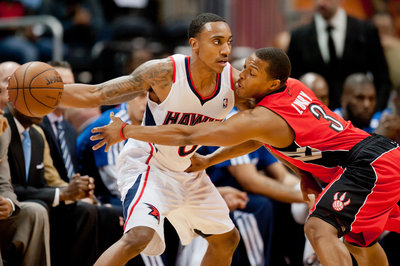 Toronto Raptors point guard Kyle Lowry (3) defends Atlanta Hawks point guard Jeff Teague (0) (Credit: Kevin Liles-USA TODAY Sports)