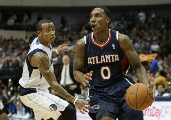 Atlanta Hawks point guard Jeff Teague (0) gets by Dallas Mavericks guard Monta Ellis, left, on a drive to the basket in the first half of an NBA basketball game, Wednesday, Oct. 30, 2013, in Dallas.