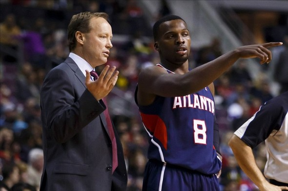 Nov 22, 2013; Auburn Hills, MI, USA; Atlanta Hawks head coach Mike Budenholzer talks to point guard Shelvin Mack (8) in the fourth quarter against the Detroit Pistons at The Palace of Auburn Hills. Atlanta won 96-89. Mandatory Credit: Rick Osentoski-USA TODAY Sports