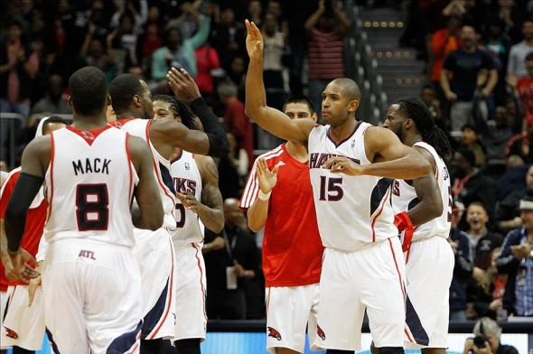 Nov 29, 2013; Atlanta, GA, USA; Atlanta Hawks center Al Horford (15) is congratulated by teammates after hitting the game-winning basket against the Dallas Mavericks in the fourth quarter at Philips Arena. The Hawks defeated the Mavericks 88-87. Mandatory Credit: Brett Davis-USA TODAY Sports