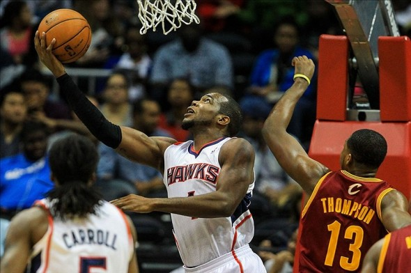 Dec 6, 2013; Atlanta, GA, USA; Atlanta Hawks power forward Paul Millsap (4) shoots a basket in the first quarter against the Cleveland Cavaliers at Philips Arena. Mandatory Credit: Daniel Shirey-USA TODAY Sports